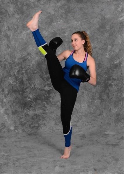 woman performing a high kick
